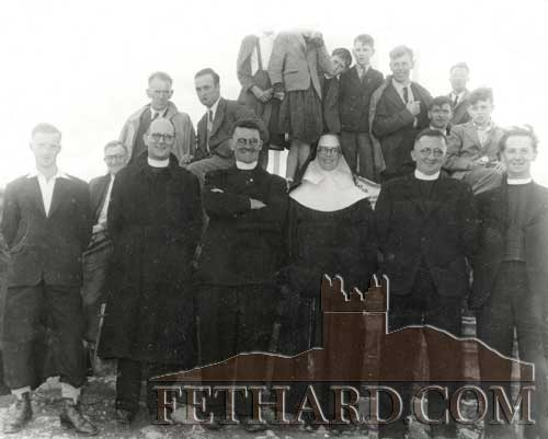Group photographed with Fr. John Lambe at Holy Year Cross on Slievenamon in the 1950s