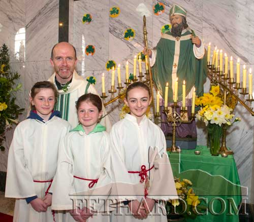 Fr. Anthony McSweeney photographed with altar servers after St. Patrick's Day Mass in Holy Trinity Parish Church. L to R: Lucy Spillane, Nell Spillane and Allison Connolly