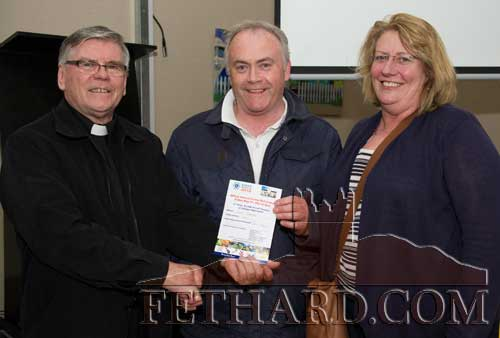 Canon Tom Breen P.P. presenting Ger and Suzanna Manton with their second prize of €1,500 Travel Voucher in the Fethard Gathering Festival 'Bring them Home' draw.