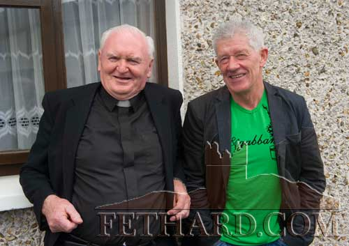 Photographed at the unveiling of a plaque to honour Con and George Moulson are L to R: Fr. Bernard Frawley and Michael Halley.
