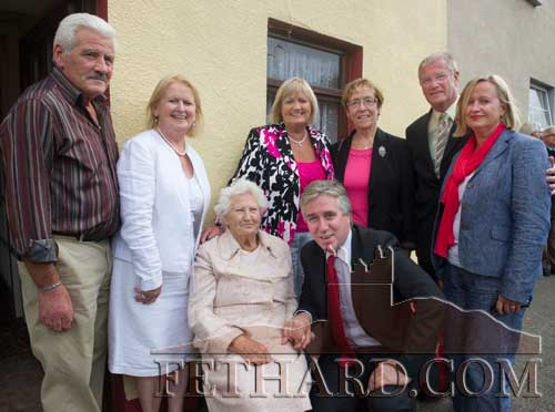 John Moulson, a son of George Moulson, photographed with some of his Fethard relatives at the unveiling of a plaque in Clogheen to honour Con and George Moulson, Republic of Ireland Soccer Internationals (1939-1948). Back L to R: Louis Coen, Ann  (Hurley) Corrigan, Breda (Hurley) O'Reilly, Janey and John Moulson, Vicky (Hurley) Fitzpatrick. Front L to R: Madge Hurley and John Delaney, CEO FAI. Madge Hurley's mother was a sister of Bridget (Dahill) Moulson, who was the mother of Con and George Moulson.