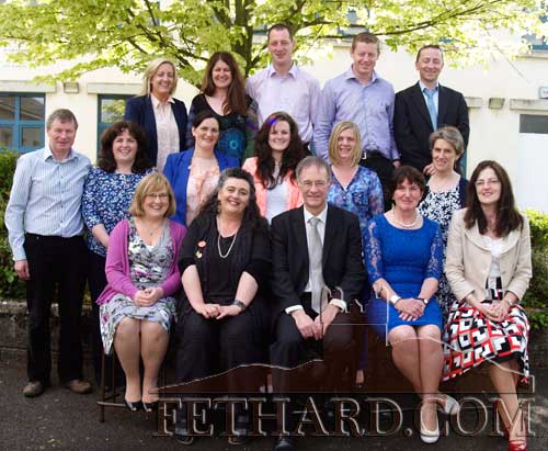 Ernan Britton photographed with staff members on the ocassion of his retirement