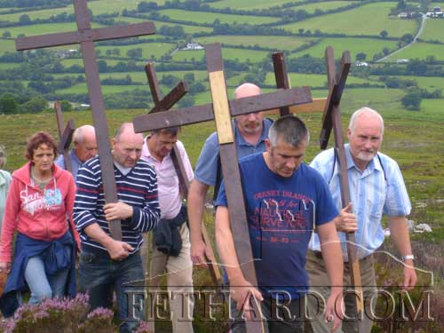 Carrying the Station Crosses on their pilgrimage to Holy Year Cross on Slievenamon are L to R: Mary Prout, Gerry Fogartry, Philly Prout, Paddy Kenrick, Mark Conaghton, Martin Coen and Joe Lee