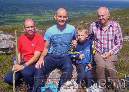 Photographed at the Annual Pilgrimage to Holy Year Cross on Slievenamon are L to R: Thomas Cuddihy,  John & Sean McEvoy (Killusty) and John Cuddihy (Sean's grandfather) from Drangan.