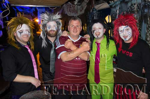 Denis O'Meara (centre) photographed with the Wig Wam Glam Band from Cashel who played at his 50th birthday celebration last weekend in Lonergans Bar.