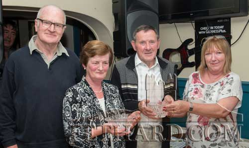 Joe Keane, winner of the Fethard Sports Achievement Award for June, accepting the award also on behalf of his community games colleague Peggy Colville. L to R: Denis Burke (special guest), Mary Godfrey, Joe Keane and Ann Butler, representing this month's sponsor, Butlers Sports Bar.
