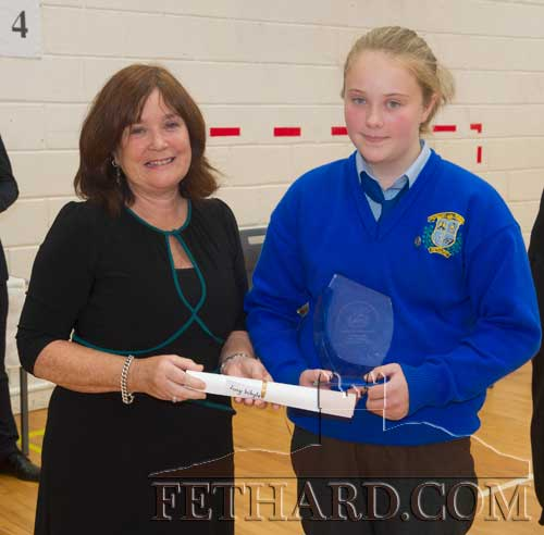 Mary O'Connor, daughter of the late Timmy O'Connor presenting the first Timmy O'Connor 'Spirit of the School Award' to Lucy Whyte, Coleman. The late Timmy was Deputy Principal of the school up to his retirement in 1988.