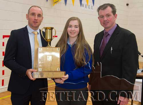 Special Guest, Eoin Kelly, presenting the Padraig Pearse Award (Best Junior Cert Irish, History and English) to Sadhbh Horan, Tullamaine. L to R: Eoin Kelly, Sadhbh Horan and Mr. Michael O'Sullivan (Principal).