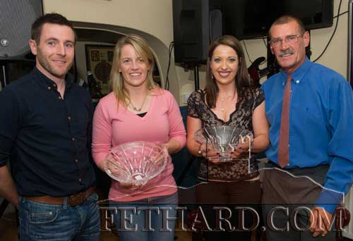 Joint winners in the July Fethard Sports Achievement Awards photographed receiving their awards on Friday last. L to R: Declan Ryan representing this month's sponsor Dalcassian Wines & Spirits, Dublin; Evana McCutcheon; Clodagh Brett who accepted the award on behalf of her daughter Keri; and special sporting guest, Michael McCarthy from England.