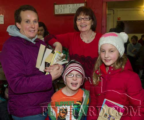 Linda Kelly (left), Killenaule, with her children Nicholas and Isobel, speaking to Mary Hanrahan at the Tipperariana Bookfair