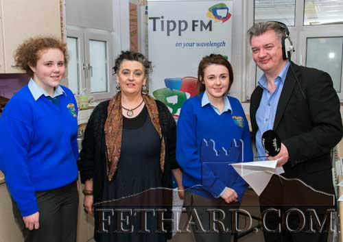 Discussing Fethard Patrician Presentation Secondary School's two entries in the national Junk Kouture competition are L to R: Katie Whyte ('Arctic Queen' entry), Ms Pat Looby (Art Teacher), Alannah Coady ( 'Candy Crush' entry) and Fran Curry (Tipp FM).