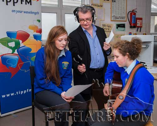 Fran Curry (Tipp FM) recording Annie Prout (left) and Katie Whyte performing for the Patrician Presentation Secondary School 'Classic Café' broadcast from the school.
