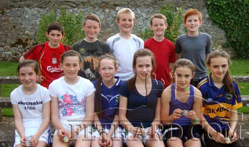 Group of medal winners at the Fethard Community Games Athletics evening. Back L to R: Ben Coen, Cathal Ryan, Ryan Walsh, Keenan Aherne, Cathal O'Mahoney. Front L to R: Laura Harrington, Lucy Spillane, Ciara Spillane, Laura O'Donnell, Leah Coen and Alison Connolly.