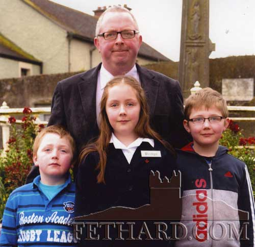 Paul Duggan, Killusty, photographed with his children Jacques, Phoebe and Andy on the occasion of Phoebe' Confirmation in Holy Trinity Parish Church, Fethard.