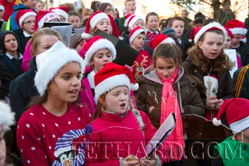 Pupils from Holy Trinity National School, Fethard, singing Christmas carols as they await the arrival of Santa to switch on the Christmas lights