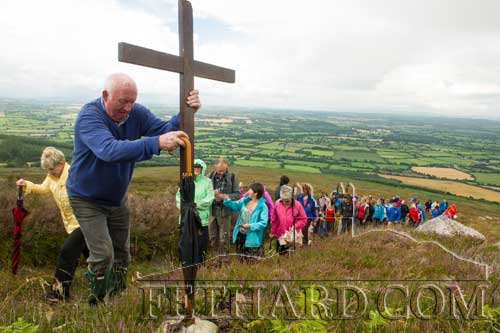 Willie Ryan fixes the cross during the Stations on Slievenamon.