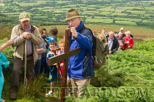 John Lee fixes a cross during the Stations with Percy Butler at the Holy Year Corss pilgrimage on Slievenamon.