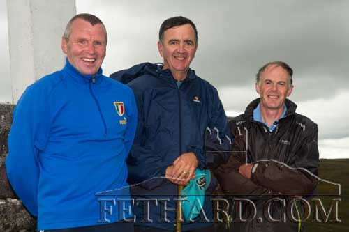 Photographed at the annual Holy Year Cross pilgrimage on Slievenamon are Willie O'Meara, Paddy Kenrick, and Michael Healy.