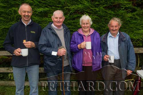 Enjoying a refreshing cup of tea after the annual Holy Year Cross pilgrimage on Slievenamon are Billy Prout, Jim Williams, Kay Williams and Christy Williams.