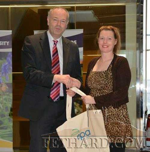 Clodagh Blake received her photography prize from RTE's Gerry Fleming, headman at Met Eireann