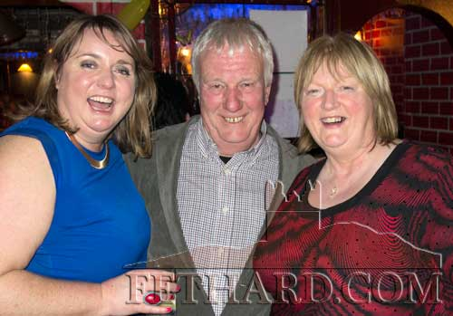 Enjoying the New Year in Lonergan's Bar were L to R: Maeve Maddock, Jimmy Purcell and Delores O'Donnell.