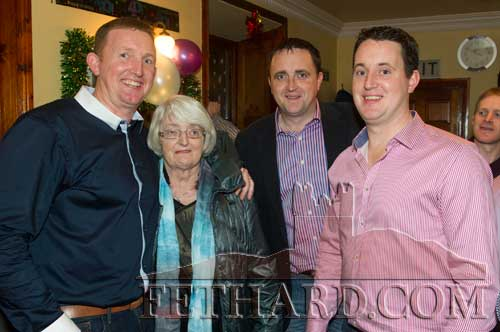 P.J. Ahearne, celebrating his 40th Birthday is photographed with his mother Monica and brothers Gerry and Michael at The Well Bar on New Year's Eve.