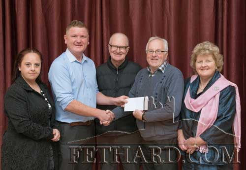 Paddy Ryan, originally from St. Patrick's Place, Fethard, presenting a cheque to the Fethard Critical Illness Fund on hehalf of his late partner Gemma Slattery. Photographed at the presentation L to R: Gina Slattery, Paddy Ryan, Dinny Burke, Walty Moloney and Nellie Ryan.