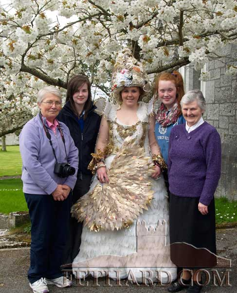 Students, Orla Walsh, Katie White ('Arctic Queen') and Louise Fitzgerald, photographed under the Apple Blossom tree with Sr. Betty and Sr. Maureen in the convent grounds.