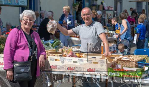 Popular street trader Willie O'Connell, Lisronagh, selling his fresh garden produce to Pauline Morrissey at the Fethard Country Market's day outside the Town Hall.