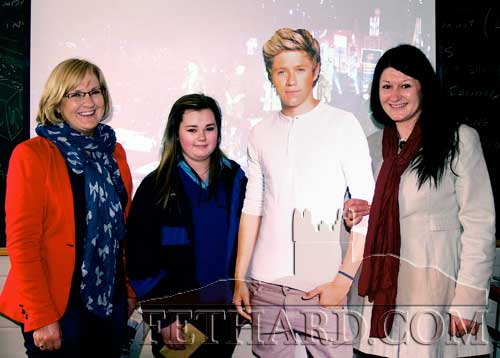 Cassie Needham (centre) who was the winner of tickets to the upcoming One Direction concert photographed with teachers Cathriona McKeogh (left) and Majella Whelan (right).