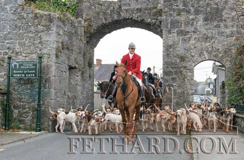 Derry Donegan leading the Tipperary Foxhounds through Fethard's North Gate at their Opening Meet
