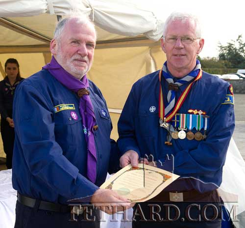 Chief scout, Michael John Shinnick (left) conferring the Order of Cú Chullainn award, the highest level in scouting, to Robert Phelan.