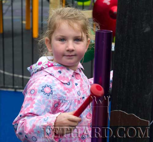 Sarah Cuddihy playing in the new Sensory Musical Garden at Fethard Playground