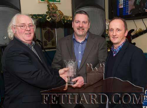Paul Tobin (centre) winner of the Butlers Bar Fethard Sports Achievement Award for December, receiving his prize from special guest Miceál McCormack. Also included is this month's sponsor Ken Moloney (right) representing Heineken.