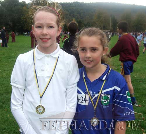 Ciara Spillane, Tullamaine and Kaycie Ahearn, Prospect, who won gold and silver medals in the 3rd and 4th classes combined race at the schools cross country in Marlfield last Wednesday
