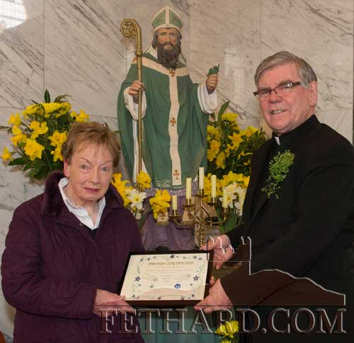 Canon Tom Breen P.P. making a presentation on behalf of Fethard Scouts to Mary O'Donnell, Market Hill, to mark her 27 years prolonged and profound service to 27th Tipperary Scout Group in Fethard.