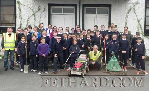 Fethard Tidy Towns members photographed with local school children from Holy Trinity National School who helped with the Fethard 'clean-up'.