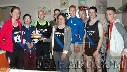 Fethard AC members make a surprise presentation of a cake to club secretary Nicola Neylon who celebrated her birthday on the same day as the Walls of Fethard 6k.