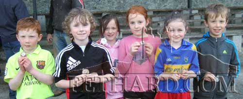Medal winners in the under 8 events L to R: Daniel Barry, Noah O'Flynn, Sarah Moore, Saoirse Burns, Rebecca Kiel and Gavin Neville.