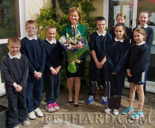 Deirdre Clune MEP photographed with Holy Trinity National School's Student Council after being presented with a bouquet of flowers at the school in Fethard.