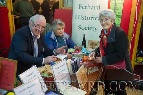 Photographed at Fethard Historical Society's stall are L to R: Tony Hanrahan, Marie Crean and Mossie Hayes.