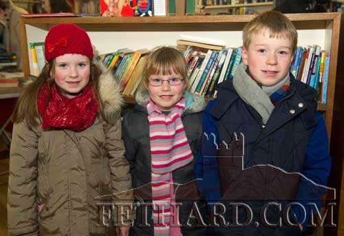 Photographed at the 20th Annual Tipperariana Book Fair in Fethard are L to R: Isabelle, Claire and David O'Donnell from Fethard.