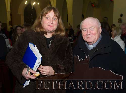 Photographed at the Christmas Carol Service at Holy Trinity Church of Ireland Fethard are L to R: Ann Barry and Fr. Martin Crean OSA