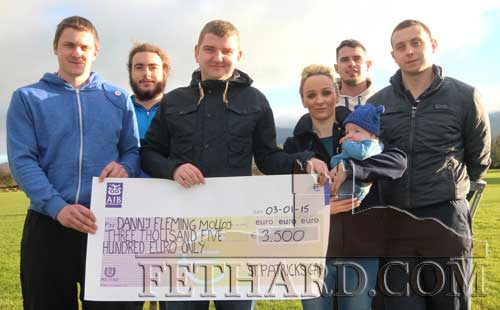 St. Patrick's GAA representatives presenting a cheque to the parents of Danny Molloy, Fethard. Back L to R: Conor Cuddihy, Robert McCormack. Front L to R: Patrick Moroney, Dermot Molloy, Carol Fleming holding baby Danny and John Moroney