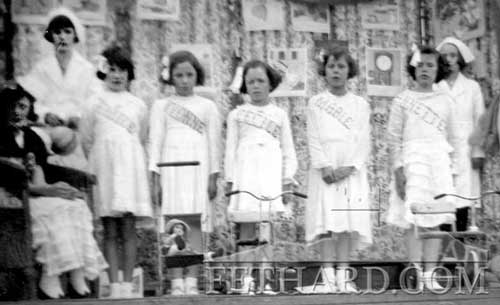 The French 'Dionne' Quints' at Fethard Carnival back in the 1940s. Includes: Maureen O'Donnell (Yvonne), Mary Kenny (Cecile), Goldie Newport (Annette), Noddy Hennessy (nurse). The Dionne Quintuplets were born May 28, 1934, and are the first quintuplets known to have survived their infancy. The identical sisters, Yvonne, Annette, Cécile, Émilie and Marie were born in Canada, just outside Callander, Ontario, near the village of Corbeil. All five survived to adulthood.