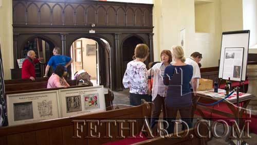 Mary Hanrahan speaking to visitors at the Fethard Historical Society's display in Holy Trinity Church of Ireland