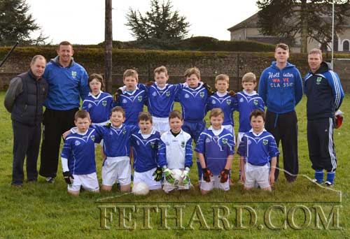 Fethard U12 team photographed with coaches in the 'new-look' school sports field.