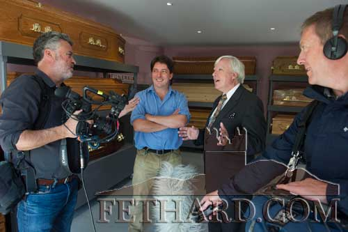 Proprietor of McCarthy's Bar, Vincent Murphy and Francis Brennan, presenter of TV series 'At Your Service' speaking with the film crew during filming at McCarthy's funeral parlour.