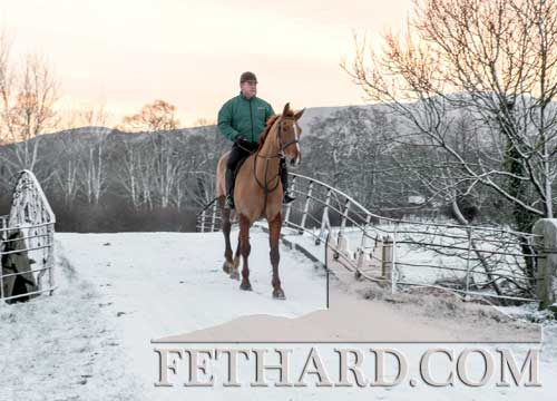 Sean Brett enjoying the frosty weather at Grove while out for a ride on his horse.