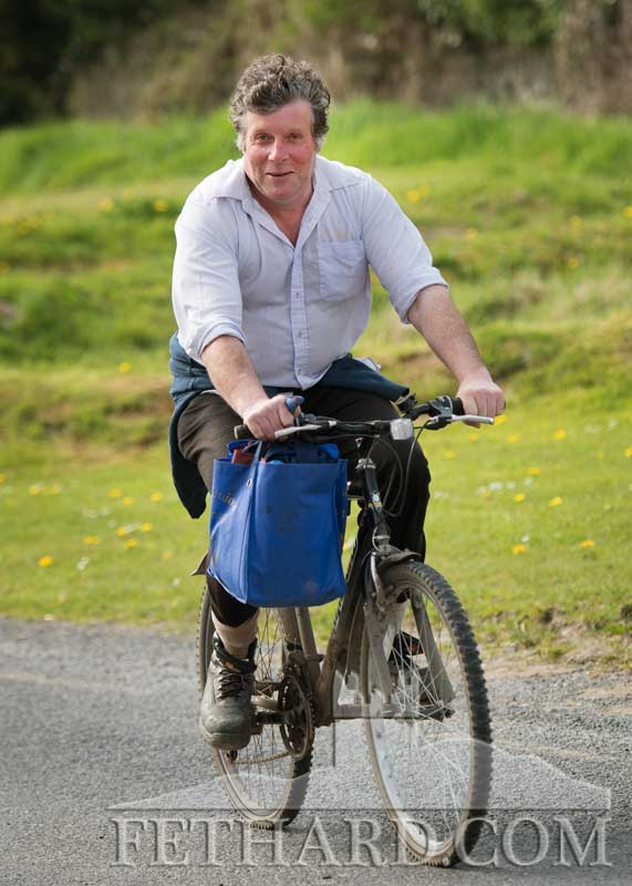 T.J. Sheehan, making his way home by bicycle to Killusty with his bag of groceries on the handlebars – a reminder of the many people and well-known characters who cycled from Fethard to Killusty, and Slievenamon, over the years.